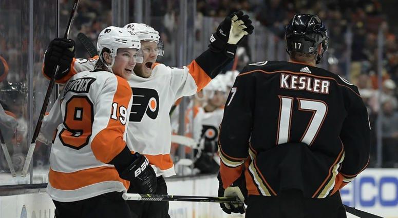 Philadelphia Flyers center Nolan Patrick, left, celebrates his goal with center Claude Giroux as Anaheim Ducks center Ryan Kesler (17) skates by.