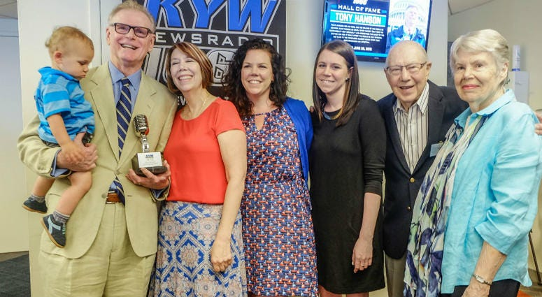 Retired KYW Newsradio reporter Tony Hanson is shown with his family in the KYW Newsradio newsroom.