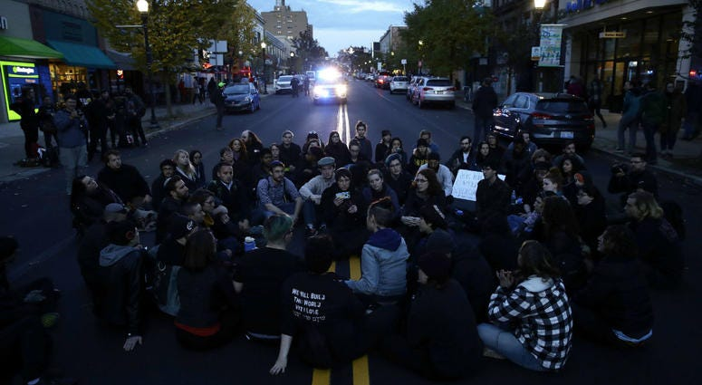 Protesters demonstrate on a main road in the Squirrel Hill neighborhood of Pittsburgh Tuesday, Oct. 30, 2018.