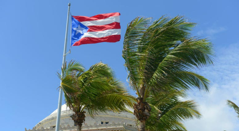 Flag of the Commonwealth of Puerto Rico in front of Capitolio, San Juan, Puerto Rico.