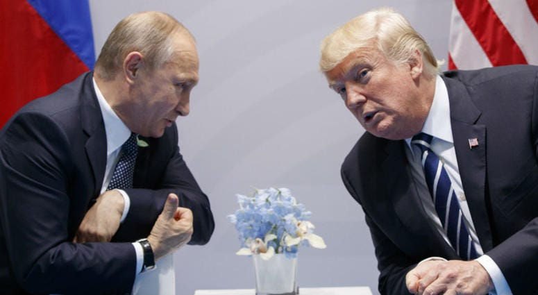 In this Friday, July 7, 2017, file photo U.S. President Donald Trump meets with Russian President Vladimir Putin at the G-20 Summit in Hamburg.