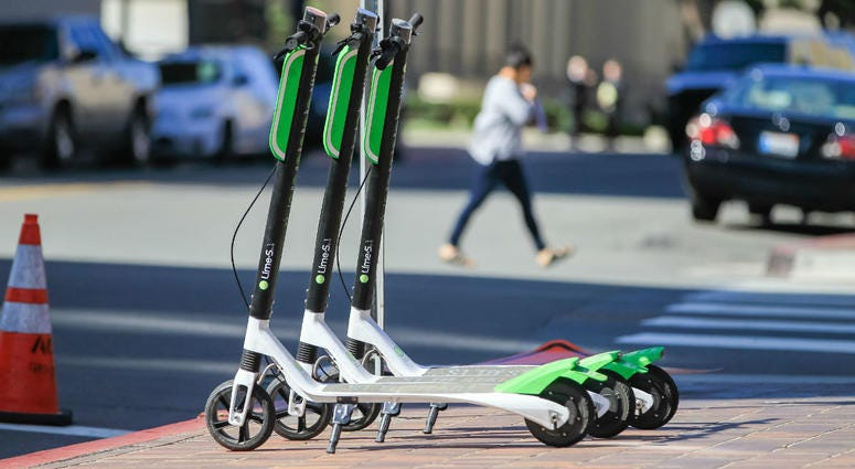 LimeBike scooters for rent on the corner of F Street and Front Street in downtown San Diego on March 1, 2018.