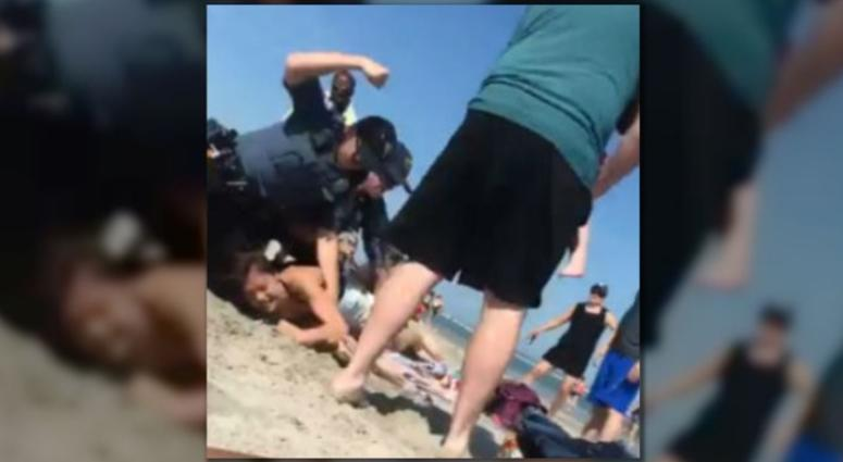 An investigation is underway after video shows a New Jersey police officer striking a woman several times during a beach arrest.