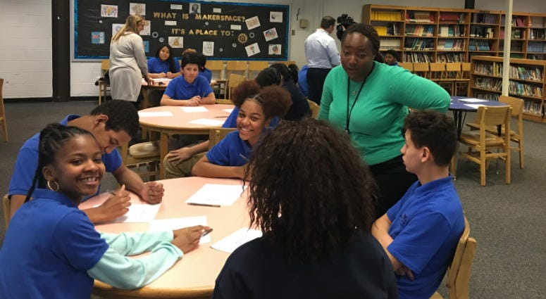 Mastery East Camden Charter School Principal Meaghann Lawson engages with students during a presentation on engineering as a career path.
