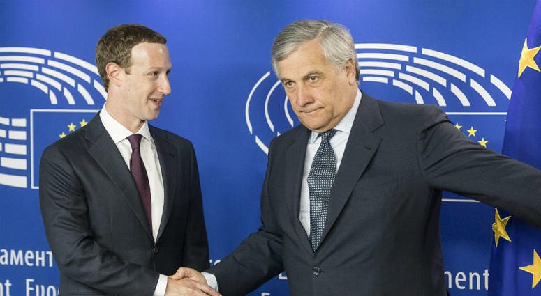 Mark Zuckerberg shakes hands with European Parliament President Antonio Tajani
