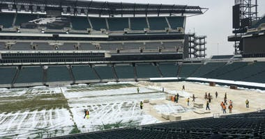 Crews have arrived at Lincoln Financial Field to build a hockey rink for the Flyers' outdoor game there.