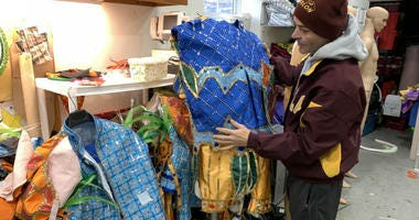 Avalon String Band costume coordinator Jimmy Tatar takes a final look at the band's outfits for the Mummers parade.