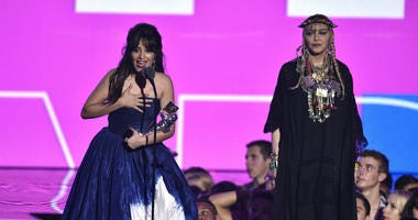Camila Cabello, left, accepts the award for video of the year as presenter Madonna looks on at the MTV Video Music Awards at Radio City Music Hall on Monday, Aug. 20, 2018, in New York.