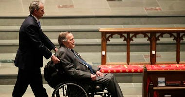 Former Presidents George W. Bush,and George H.W. Bush arrive for a funeral service for former First Lady Barbara Bush.