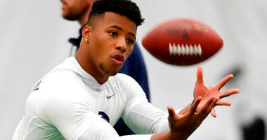 Running back Saquon Barkley catches a football during Penn State NFL football Pro Day.