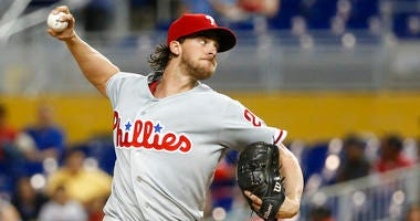 Philadelphia Phillies' Aaron Nola delivers a pitch during the first inning of the team's baseball game against the Miami Marlins.