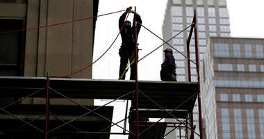 Construction workers work in midtown Manhattan in New York. U.S. productivity grew at an annual rate of 0.7 percent in the first three months of 2018, a weak reading but a slight improvement from the previous quarter.