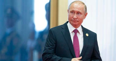 Russian President Vladimir Putin arrives to attend the Shanghai Cooperation Organization (SCO) Summit in Qingdao.