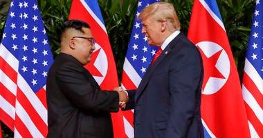 U.S. President Donald Trump shakes hands with North Korea leader Kim Jong Un at the Capella resort on Sentosa Island.