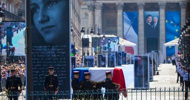 The flag-draped coffin of late Auschwitz holocaust survivor and French health minister Simone Veil, is carried during a national tribute before being laid to rest in the crypt of the Pantheon mausoleum in Paris.