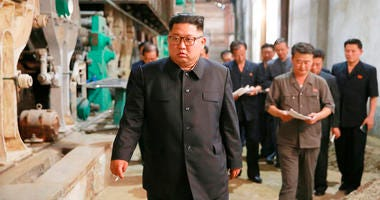 In this undated photo provided on July 2, 2018, by the North Korean government, North Korean leader Kim Jong Un, center, visits Sinuiju Chemical Fibre Mill in Sinuiju, North Korea.