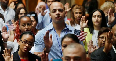 New citizens participate in a naturalization ceremony, Tuesday, July 3, 2018, at the New York Public Library. Two hundred people from 50 countries gained citizenship.