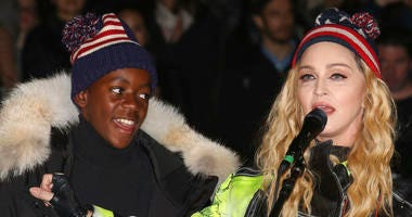In this Nov 7, 2016 file photo, U.S. Singer Madonna, right, and her son David Banda perform in support of Democratic presidential candidate Hillary Clinton at Washington Square Park.