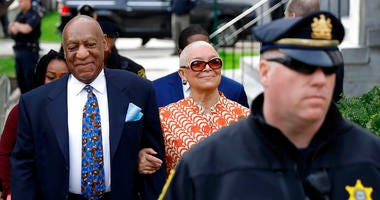 In this April 24, 2018, file photo, Bill Cosby, left, arrives with his wife, Camille, for his sexual assault trial, at the Montgomery County Courthouse in Norristown, Pa.