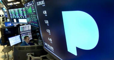In this Feb. 22, 2018, file photo, the Pandora logo appears above a trading post on the floor of the New York Stock Exchange.