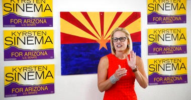 ILE - In this Aug. 28, 2018, file photo, Rep. Kyrsten Sinema, D-Ariz., talks to campaign volunteers at a Democratic campaign office in Phoenix.