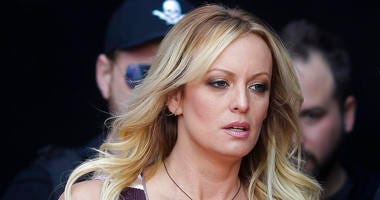 """FILE - In this Thursday, Oct. 11, 2018, file photo, adult film actress Stormy Daniels arrives for the opening of the adult entertainment fair """"Venus,"""" in Berlin."""