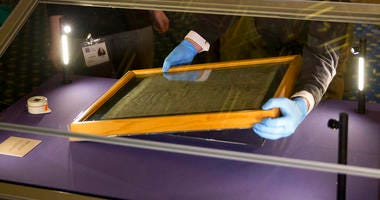 FILE - In this file photo dated Thursday, Feb. 5, 2015, The Salisbury Cathedral 1215 copy of the Magna Carta is installed in a glass display cabinet marking the 800th anniversary of the sealing of Magna Carta at Runnymede in 1215, in Salisbury, England.