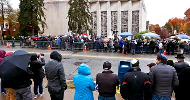 People line both sides of the street as they gather outside the Tree of Life Synagogue for a service on Saturday, Nov. 3, 2018, in Pittsburgh.