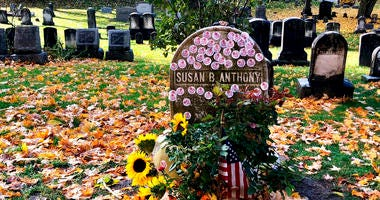 """Voters showed up by the dozens to put their """"I Voted"""" stickers on the headstone, an Election Day ritual that pays homage to the voting rights pioneer."""