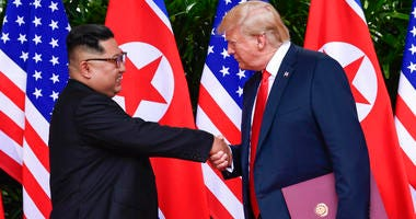 FILE - In this June 12, 2018, file photo, North Korean leader Kim Jong Un, left, and U.S. President Donald Trump shake hands at the conclusion of their meetings at the Capella resort on Sentosa Island in Singapore.