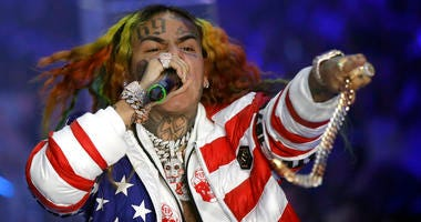 FILE- In this Sept. 21, 2018, file photo rapper Daniel Hernandez, known as Tekashi 6ix9ine, performs during the Philipp Plein women's 2019 Spring-Summer collection, unveiled during the Fashion Week in Milan, Italy.
