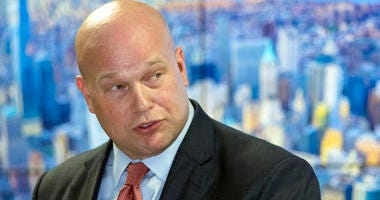 In this Nov. 21, 2018 photo, Acting Attorney General Matthew Whitaker, framed by a photograph of lower Manhattan, addresses law enforcement officials at the Joint Terrorism Task Force in New York.