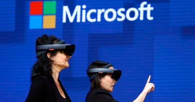 FILE- In this May 11, 2017, file photo, members of a design team at Cirque du Soleil demonstrate use of Microsoft's HoloLens device in helping to virtually design a set at the Microsoft Build 2017 developers conference in Seattle.