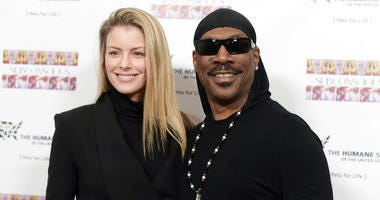 """FILE - In this Nov. 20, 2016, file photo, Paige Butcher, left, and Eddie Murphy attend """"SUBCONSCIOUS"""" by Bria Murphy Gallery Opening at Lace Gallery in Los Angeles."""