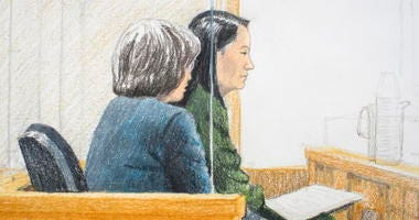 In this courtroom sketch, Meng Wanzhou, right, the chief financial officer of Huawei Technologies, sits beside a translator during a bail hearing at British Columbia Supreme Court in Vancouver, on Friday, Dec. 7, 2018.