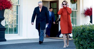 House Minority Leader Nancy Pelosi of Calif., right, and Senate Minority Leader Sen. Chuck Schumer of N.Y., left, walk out of the West Wing to speak to members of the media outside of the White House, Dec. 11, 2018.
