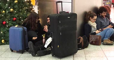 Passengers wait at Gatwick Airport in England, Friday, Dec. 21, 2018.