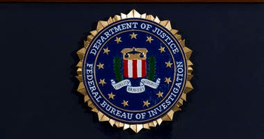FILE - In this June 14, 2018, file photo, the FBI seal is seen before a news conference at FBI headquarters in Washington.