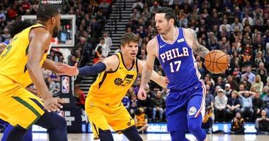 Philadelphia 76ers guard JJ Redick (17) is defended by Utah Jazz guard Kyle Korver (26) during the second quarter of an NBA basketball game Thursday, Dec. 27, 2018, in Salt Lake City.