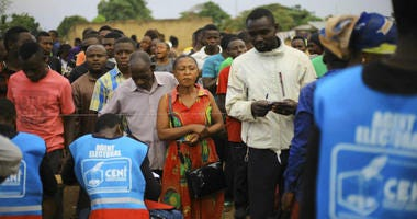 Congolese participate in a mock voting in the Eastern Congolese town of Beni Sunday Dec. 30, 2018.