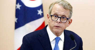 FILE- In this Nov. 13, 2018, file photo Ohio Attorney General Mike DeWine speaks during a news conference in Waverly, Ohio.