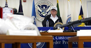 With illegal drugs and weapons displayed in the foreground, President Donald Trump speaks at a roundtable on immigration and border security at U.S. Border Patrol McAllen Station, during a visit to the southern border, Thursday, Jan. 10, 2019, in McAllen,