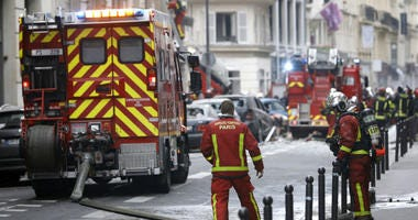 Firefighters work at the scene of a gas leak explosion in Paris, France, Saturday, Jan. 12, 2019.