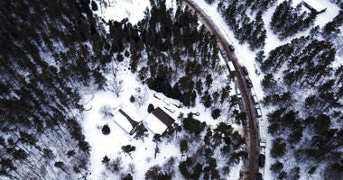 This aerial photo shows the cabin where 13-year-old Jayme Closs was held by Jake Thomas Patterson, is surrounded by law enforcement vehicles, Saturday, Jan. 12, 2019 in the town Gordon, Wis.