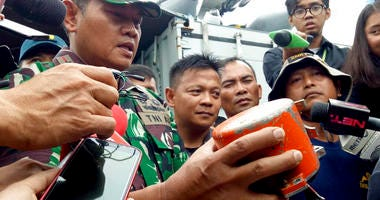 Indonesian Navy Commander Rear Admiral Yudo Margin shows the recovered cockpit voice recorder of Lion Air flight 610 during a press conference on board the navy ship KRI Spica in the waters off Tanjung Karawang, Indonesia, Jan. 14, 2019.