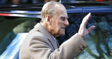 FILE - In this Sunday, Dec. 25, 2016 file photo, Britain's Prince Philip waves to the public as he leaves after attending a Christmas day church service in Sandringham, England.
