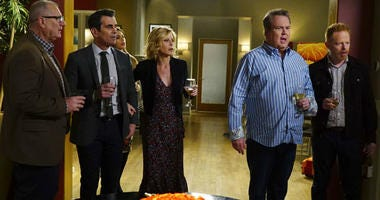"This image released by ABC shows, from left, Ed O'Neill, Ty Burrell, Sofia Vergara, obscured, Julie Bowen, Eric Stonestreet and Jesse Tyler Ferguson in a scene from ""Modern Family."""