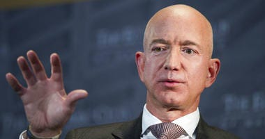 FILE- In this Sept. 13, 2018, file photo Jeff Bezos, Amazon founder and CEO, speaks at The Economic Club of Washington's Milestone Celebration in Washington.