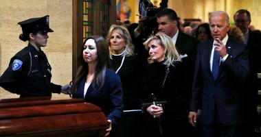 Congresswoman Debbie Dingell, center, follows the casket procession out of the Church of the Divine Child after a funeral mass for her husband John Dingell, Tuesday, Feb. 12, 2019, in Dearborn, Mich.