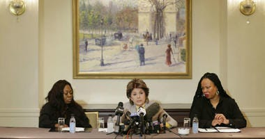 Attorney Gloria Allred, center, speaks while Latresa Scaff, right, and Rochelle Washington look on during a news conference in New York, Thursday, Feb. 21, 2019.